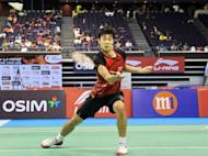 Thailand's Boonsak Ponsana hits a return against Wang Zhengming of China in the men's singles final at the Singapore Open super series badminton tournament in Singapore. Ponsana claimed his second Singapore Open men's singles title after beating China's Wang Zhengming in a hard-fought final