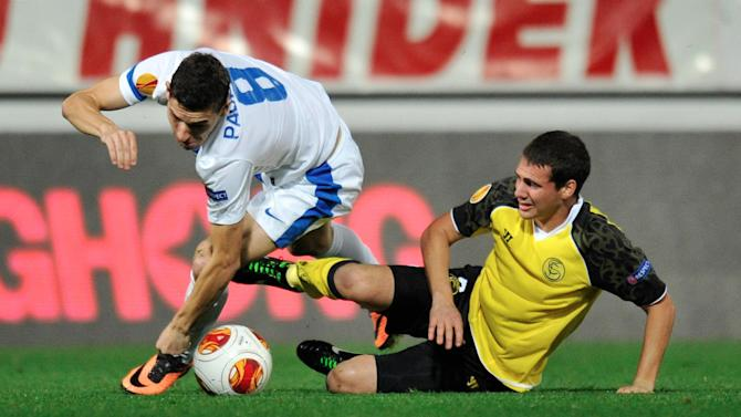 Sebastian Cristoforo from Sevilla FC, right,  fights for the ball with David Pavelka from Slovan Liberec, left, during their Europa League group H soccer match  in Liberec, Czech Republic, Thursday, Oct. 24, 2013.  (AP Photo, CTK, Radek Petrasek)