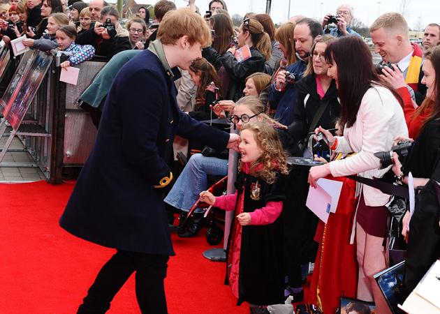 Harry Potter premiere: Rupert Grint made time to speak to a delighted young fan.