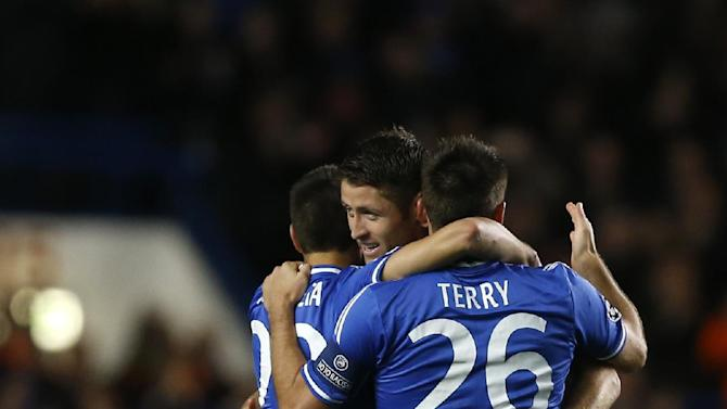 From left, Chelsea's Cesar Azpilicueta, Gary Cahill and John Terry celebrate the second goal during the Champions League group E soccer match between Chelsea and FC Schalke 04 at Stamford Bridge Stadium  in London Wednesday, Nov. 6, 2013
