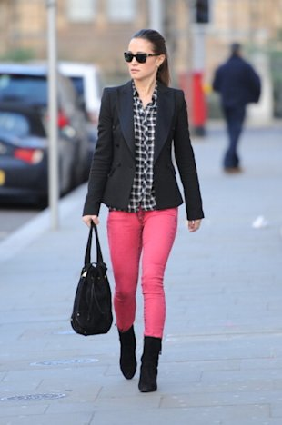Pippa Middleton isn't trying to be photographed, she's walking to work.