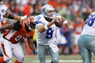 Dallas Cowboys' Tony Romo looks to pass the ball during their game against the Cincinnati Bengals on December 9. The Cowboys, grieving the death of reserve Jerry Brown in a car crash with teammate Josh Brent at the wheel, persevered to beat Cincinnati 20-19