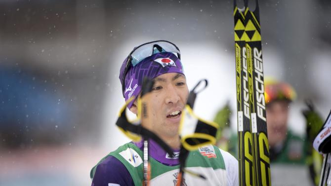 Akito Watabe of Japan celebrates after winning the Nordic Combined Individual Gundersen 10 km cross country skiing in the FIS World Cup Ski Games in Lahti