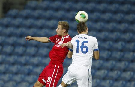Gibraltar's Priestley fights for the ball with Slovakia's Salata during their international friendly soccer match near Faro