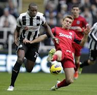 Newcastle United and Nigerian striker Shola Ameobi (L) in action against West Bromwich Albion last month. Ameobi could make his debut for Nigeria at 31 -- 10 years after turning down another approach to switch allegiances having played for England at age-limit level