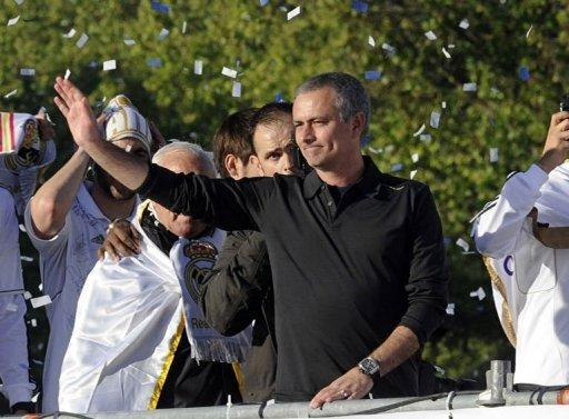 Real Madrid's coach Jose Mourinho celebrates on an open bus at Cibeles square