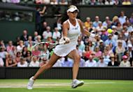 Poland's Agnieszka Radwanska plays a forehand shot during her women's singles semi-final victory over Germany's Angelique Kerber on day 10 of the 2012 Wimbledon Championships tennis tournament at the All England Tennis Club in Wimbledon, southwest London. Radwanska will meet Serena Williams in the final