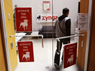 "In this June 2, 2011 photo, workers walk into Zynga headquarters in San Francisco. Based on papers filed Friday, July1, 2011, Zynga, the online game maker behind ""FarmVille"" and other popular Facebook pastimes, is going public. (AP Photo/Paul Sakuma)"