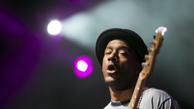 FILE - This is a Wednesday, May 23, 2012 file photo of  Grammy award-winning jazz bassist Marcus Miller  performs in concert at Papp Laszlo Sports Arena in Budapest, Hungary, Wednesday, May 23, 2012. Marcus Miller and several members of his band were injured when their bus overturned Sunday Nov. 25, 2012 on a busy highway in Switzerland, killing the driver, police said. (AP Photo/MTI, Balazs Mohai, File)