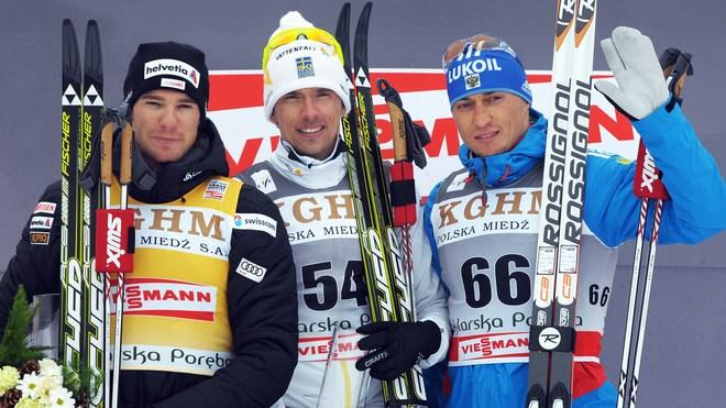 Winner Sweden's Johann Olsson (C), Second-placed Switzerland's Dario Cologna (L) And Third-placed Russia's Alexander AFP/Getty Images