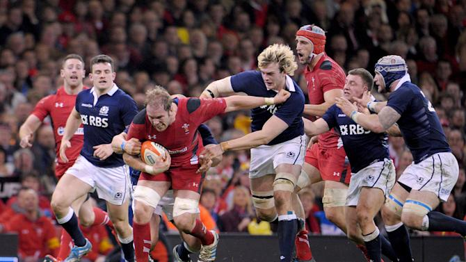Wales' Alun Wyn Jones, third left, is tackled during the Six Nations rugby union match between Wales and Scotland at the Millennium Stadium, Cardiff, Wales, Saturday, March 15, 2014. (AP Photo/Tim Ireland, PA Wire) UNITED KINGDOM OUT - NO SALES - NO ARCHIVES