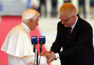 Pope Benedict XVI is welcomed by Croatia's president Ivo Josipovic, right, upon his arrival at the Zagreb airport, Croatia, Saturday, June 4, 2011. Pope Benedict XVI is on a two-day visit to Croatia.