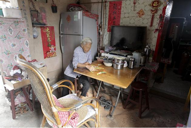 A elderly woman plays cards in her kitchen in the village of Guningtou in Kinmen