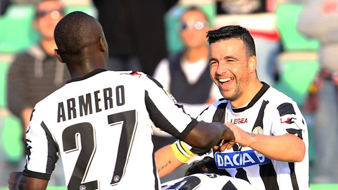 Udinese's Antonio Di Natale, top right, celebrates with teammates, L, Badu, Gabriel Torje, Pablo Armero, after scoring during the Serie A soccer match between Udinese and Palermo, at the Udine Friuli stadium Sunday, Oct. 30, 2011. (AP Photo/Paolo Giovannini)