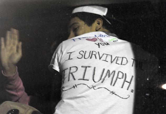 One of the passengers proudly displays his T-shirt