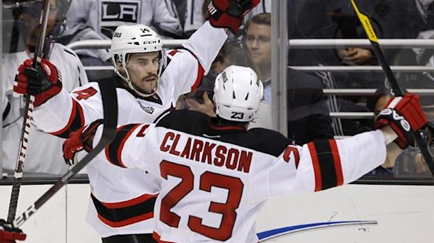 New Jersey Devils' Adam Henrique (L) celebrates with teammate David Clarkson