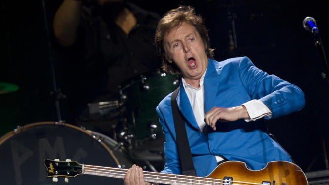 "FILE - In this Sunday, Nov. 21, 2010 file photo, British musician Paul McCartney performs during his ""Up And Coming Tour"" at the Morumbi Stadium in Sao Paulo. McCartney is kicking off the North American leg of his ""Out There"" tour in Orlando, Fla., on Saturday, May 18, 2013. The massive production, which requires 31 trucks worth of equipment, includes lasers, huge pyrotechnics, and state of the art video displays, according to the website of the former Beatles star. (AP Photo/Andre Penner, File)"
