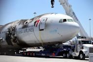 The wrecked fuselage of Asiana Airlines flight 214 sits in a storage area at San Francisco International Airport on July 12, 2013 in San Francisco, California. A third girl, reportedly Chinese, died of injuries sustained in the Asiana jet crash in San Francisco, as authorities confirmed that a firetruck ran over one of the other victims