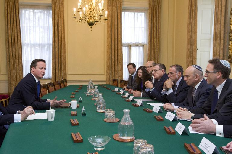 Prime Minister David Cameron (left) talks with members of the Jewish Leadership Council during their annual meeting at 10 Downing Street on Janurary ...