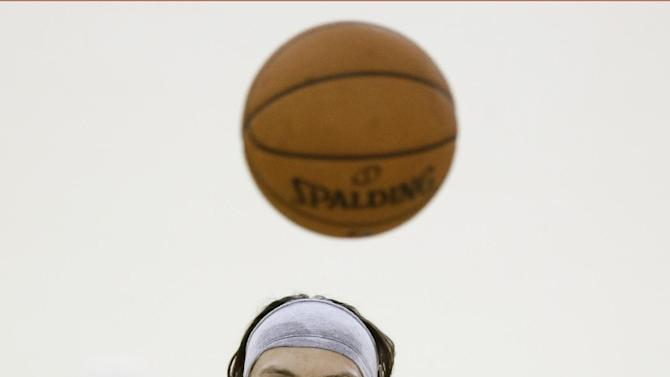 Memphis Grizzlies' Mike Miller passes the ball during NBA basketball training camp Tuesday, Oct. 1, 2013, in Nashville, Tenn. The Grizzlies are scheduled to hold training camp in Nashville through Saturday