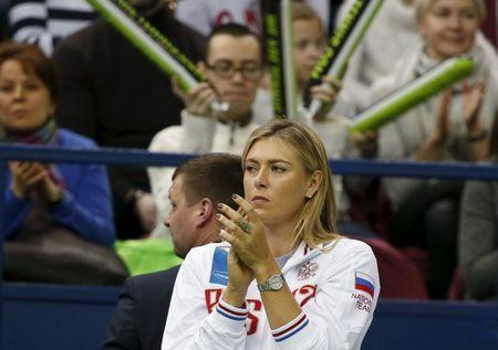 Russia's Maria Sharapova reacts as she watches compatriot Ekaterina Makarova play against Kiki Bertens of the Netherlands during their Fed Cup World Group tennis match in Moscow