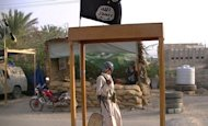 Suspected Al-Qaeda militants man a checkpoint in the area of Azzan in the southern Yemeni province of Shabwa in April 2012. The double agent who infiltrated Al-Qaeda and helped foil a plot to blow up a US-bound airliner held a British passport in addition to being a Saudi national, CNN reported