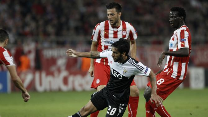 Benfica's Silvio fights for the ball next to Olympiakos Delvin N' Dinga during their Champions League soccer match at Karaiskaki stadium in Athens