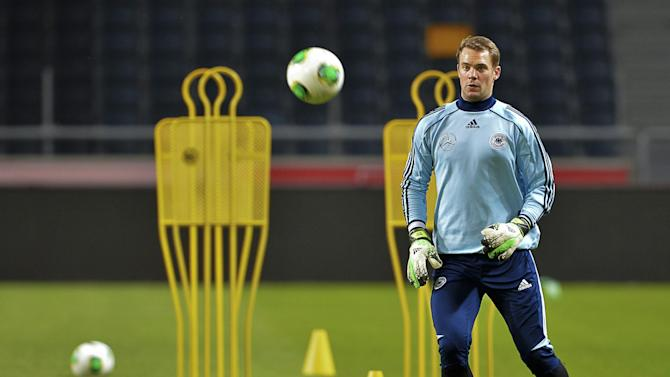 Germany's goalkeeper Manuel Neuer attends a training session at Friends Arena in Stockholm, Sweden, Monday Oct. 14, 2013. Germany will play Sweden in their World Cup qualifier match on Tuesday