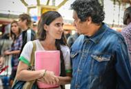 "Cuban blogger Yoani Sanchez talks to her husband, dissident Reinaldo Escobar, before departing from Havana's airport on February 17, 2013. Sanchez, 37, often criticizes the Cuban government in her ""Generation Y"" blog"