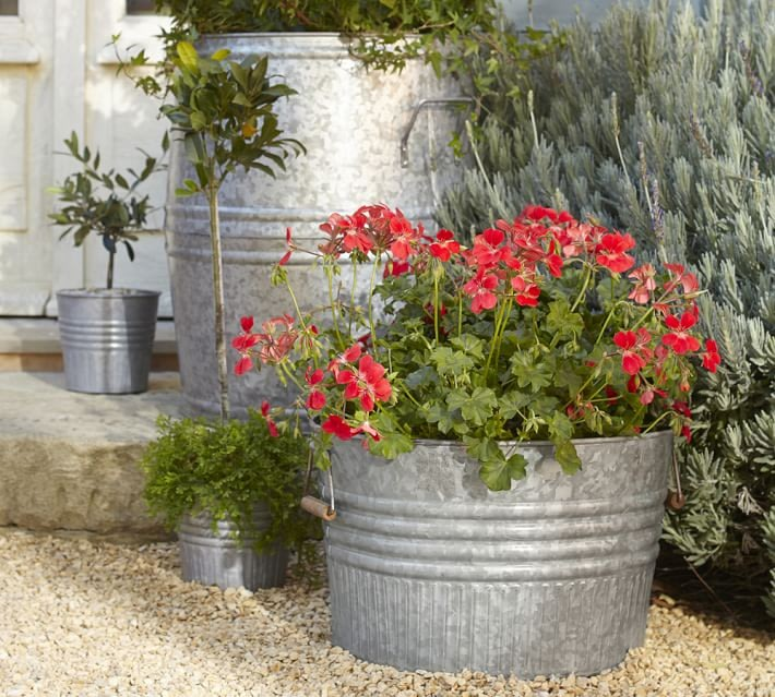 10 easy pieces zinc barrel planters yahoo homes for Large metal tub for gardening