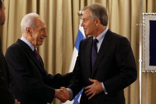 """Israeli President Shimon Peres (right) shakes hands with Tony Blair, Special Envoy of the Quartet on the Middle East, in Jerusalem on Monday. Russia on Friday said the Middle East Quartet is an """"insufficient"""" format for long-term resolution of the conflict between Israel and the Palestinians, calling on the body to work together with the Arab League"""