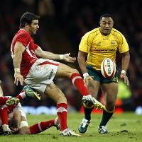 Mike Phillips, left, said to lose to Australia by just two points was 'devastation' for Wales