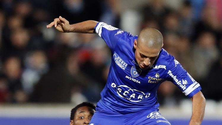 Bastia's Khazri challenges Olympique Marseille's Djadjedje during their French Ligue 1 soccer match at the Velodrome stadium in Marseille
