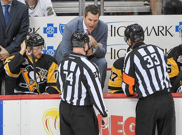 PITTSBURGH, PA - OCTOBER 20: Head coach Mike Sullivan of the Pittsburgh Penguins gets an explanation from referee Kevin Pollock #33 after a goal was waved off in second period during the game against San Jose Sharks at PPG PAINTS Arena on October 20, 2016 in Pittsburgh, Pennsylvania. (Photo by Justin Berl/Getty Images)