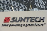 The company sign outside of Chinese company Suntech in the eastern Chinese city of Wuxi on February 27, 2012. The New York Stock Exchange said Thursday it was reviewing the listing of Suntech Power Holding Co.'s US-traded shares after the giant solar-panel maker's main China unit moved into bankruptcy reorganization