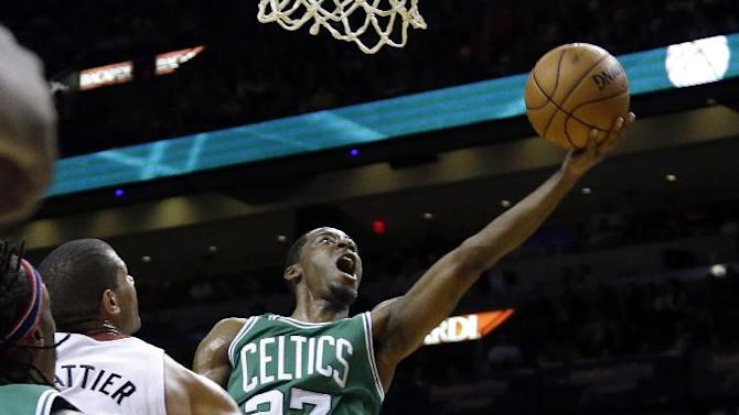 Boston Celtics' Jordan Crawford (27) shoots as Miami Heat's Ray Allen, right, stands by during the second half of an NBA basketball game Saturday, Nov. 9, 2013, in Miami. The Celtics won 111-110