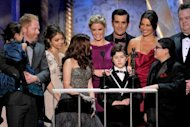 "The cast of 'Modern Family' accept at a Screen Actors Guild Award in Los Angeles in January. Cult retro series ""Mad Men"" and comedy hit ""Modern Family"" are Emmys favorites again this weekend -- but a bunch of newcomers could yet produce surprises at US television's annual awards show"