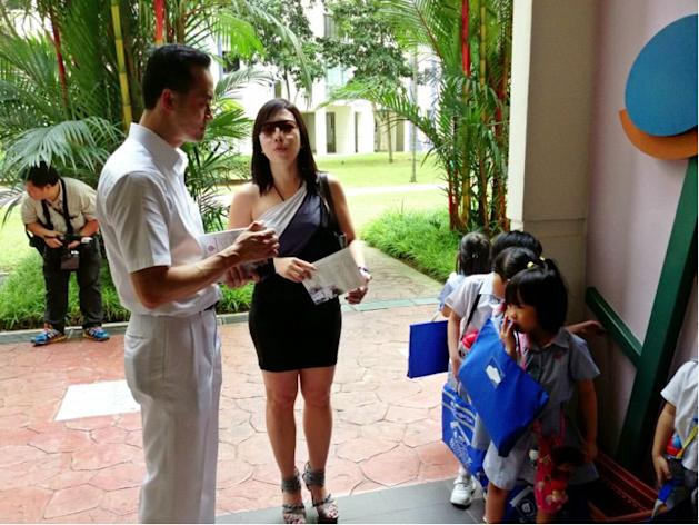 PAP's Dr Koh Poh Koon speaks to a Punggol resident, Vena Xie, on the issue of childcare centres.