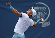 Tomas Berdych of Czech Republic serves to John Isner during their Winston-Salem Open final on August 25. Berdych, who had three chances to put away the match in the tiebreaker including one on his own serve at 6-5, looked stunned after his loss
