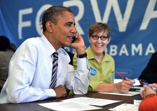US President Barack Obama calls a volunteer from a campaign office in Chicago, Illinois, on election day, November 6. In the most candid and emotional scene ever captured of Obama on camera, the normally composed US president teared up as he told young campaign workers of his pride in them