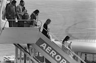 """Hostages released from the US Embassy in Tehran arrive in France on November 20, 1979. Iran's announcement that it will make its own film to counter the """"distorted"""" thriller """"Argo"""" is fueling a debate about Hollywood and historical accuracy, sparked by Ben Affleck's Oscar-tipped movie"""