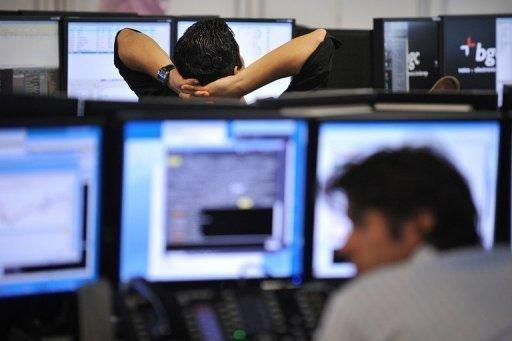 Brokers monitor market movements in London in 2011. European stock markets surged higher after the US Federal Reserve unveiled fresh plans to stimulate the economy, boosting especially the share prices of miners.