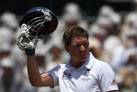 England's Ballance asks for a new helmet after being hit a ball by Australia's Johnson during the second day of the fifth Ashes cricket test at the Sydney cricket ground