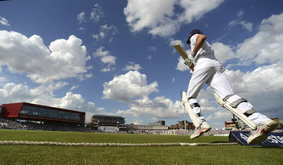 England's captain Alastair Cook runs on to the field to bat during the third Ashes cricket test match against Australia in Manchester