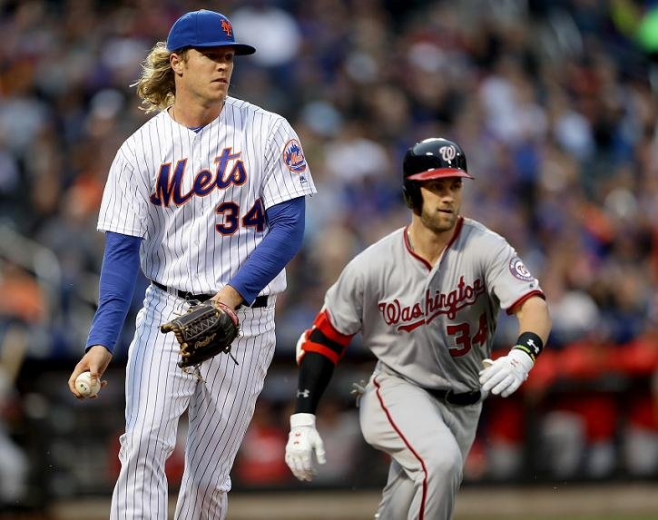 Noah Syndergaard (left) and Bryce Harper are not on the best of terms? (Getty Images)