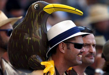 A New Zealand supporter, with an inflatable Kiwi on his shoulders, watches during the third day of the third cricket test match against Australia at the Adelaide Oval, in South Australia