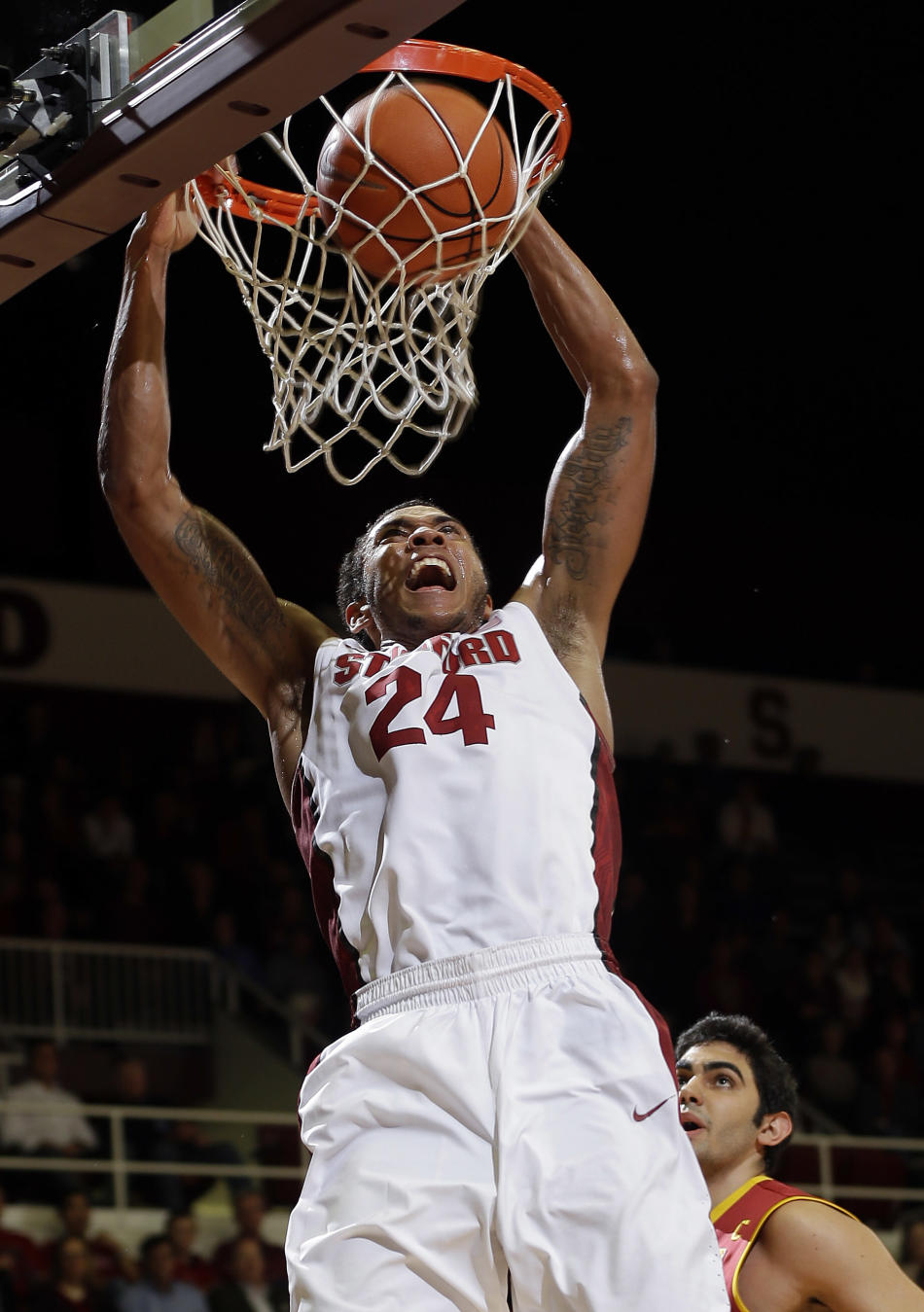 Stanford forward Josh Huestis (24) dunks against Southern California during the second half of an NCAA college basketball game on Thursday, Feb. 20, 2014, in Stanford, Calif. (AP Photo/Marcio Jose San