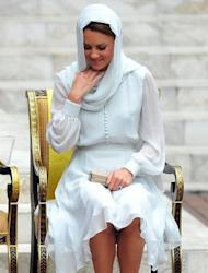 "Britain's Prince William's wife, Catherine, the Duchess of Cambridge adjusts her scarf outside a mosque in Kuala Lumpur on September 14. The British royal family have warned an Italian magazine that ""unjustifiable upset"" would be heaped on Catherine if it went ahead and printed topless photos of her"