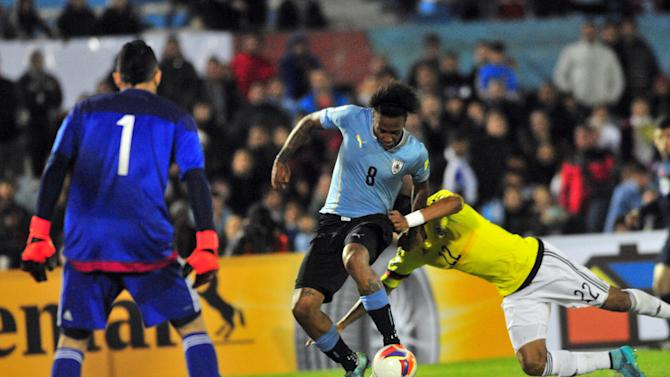 Uruguay's Abel Hernandez shoots to score against Colombia during their 2018 World Cup qualifying soccer match against Colombia at the Centenario stadium in Montevideo