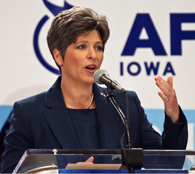 In this Oct. 23, 2013 photo is state Sen. Joni Ernst during a Senate debate in Des Moines, Iowa. In a Wednesday, March 5, 2014 press release from state Ernst, former Republican presidential nominee Mi